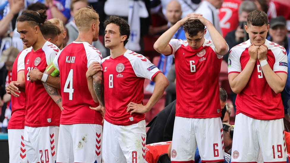 Denmark players react after Christian Eriksen collapses