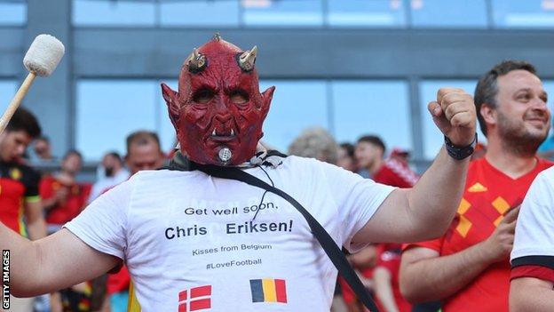 Belgium fan wears a shirt in tribute to Eriksen