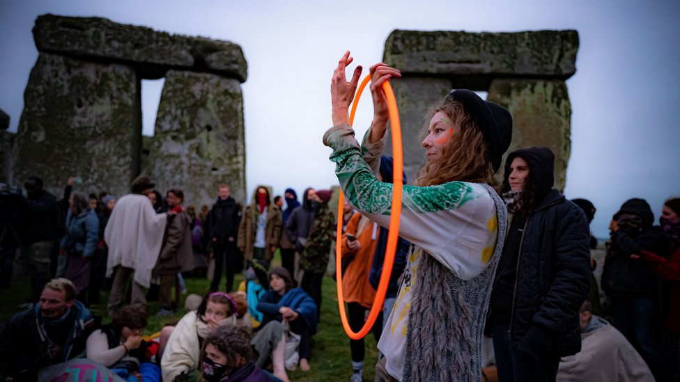 People inside the stone-circle during Summer Solstice at Stonehenge