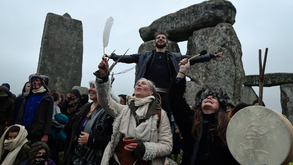 Revellers gather to celebrate the Summer Solstice at Stonehenge ancient stone circle
