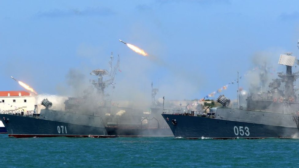 Russian ships firing missiles while take part in the Navy Day parade in Sevastopol