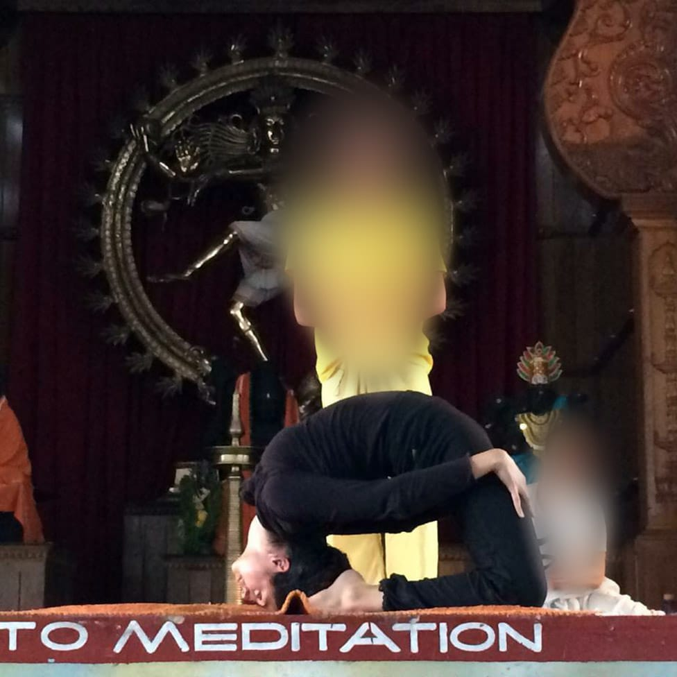 Ishleen on the stage at a Sivananda demonstration