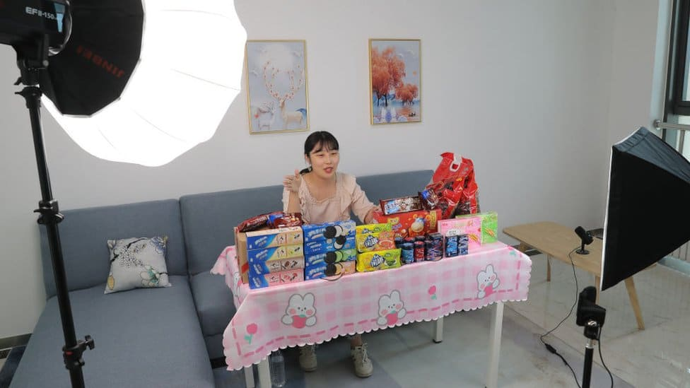 A livestreamer sells biscuits via live streaming in Tianjin, China