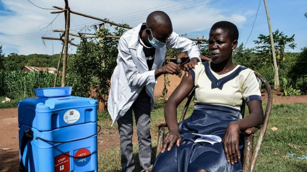 A woman being vaccinated in rural Kenya