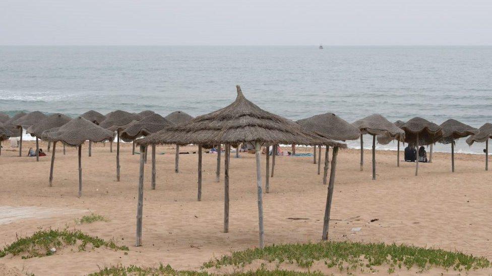 Empty huts at a Tunisian beach