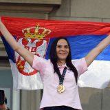 Sonja Vasić i Filip Filipović nose zastavu Srbije na otvaranju OI 7