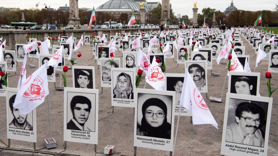 Some 800 portraits of political prisoners who were executed in Iran in 1988 after displayed by representatives in France of the People's Mujahedin Organisation of Iran on the Esplanade des Invalides in Paris (29 October 2019)
