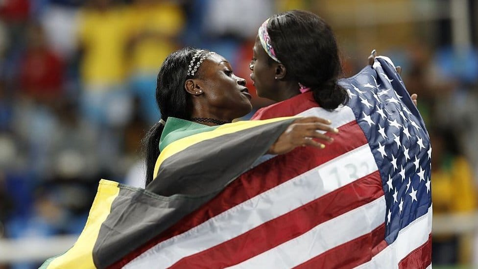 Gold medallist Elaine Thompson from Jamaica embraces silver medallist Tori Bowie from the US (R) after the women's 100m Final Rio 2016 Olympics