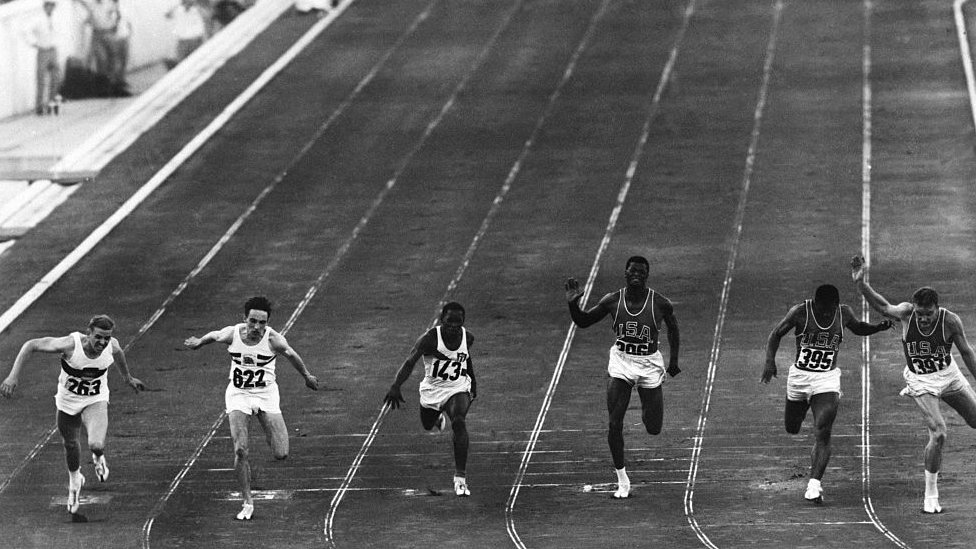 Sprinters running a 100m heat at the 1960 Rome Olympics