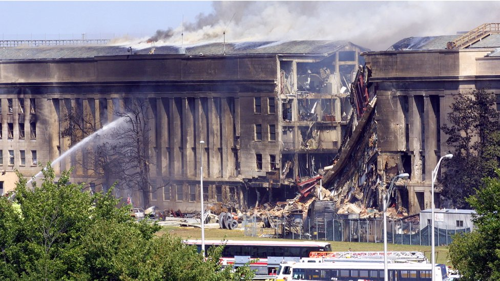 Smoke pours from the Southwest E-ring of the Pentagon building September 11, 2001 in Arlington, Virginia after a hijacked plane crashed into the building and set off a huge explosion.