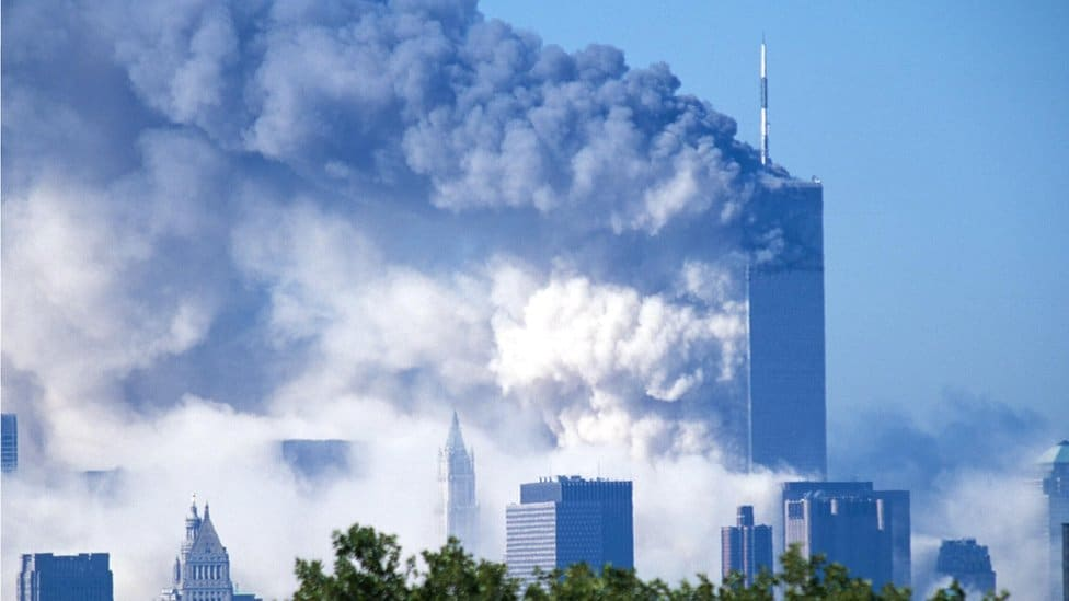 Two commercial jet liners crash into the World Trade Center, consequently causing both towers to implode and fall
