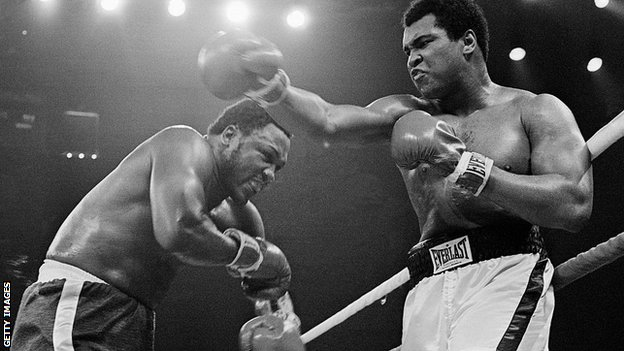 """Frazier (left) would later state he hit Ali with """"punches that'd bring down the walls of a city"""