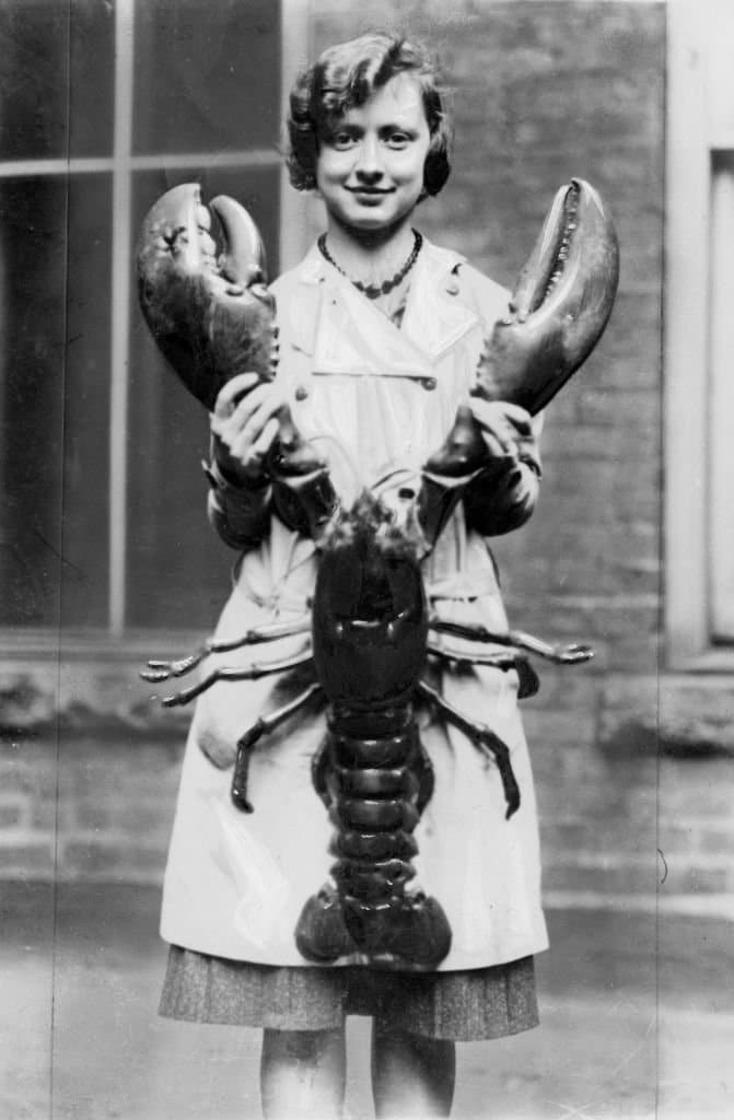 A girl holding a giant lobster