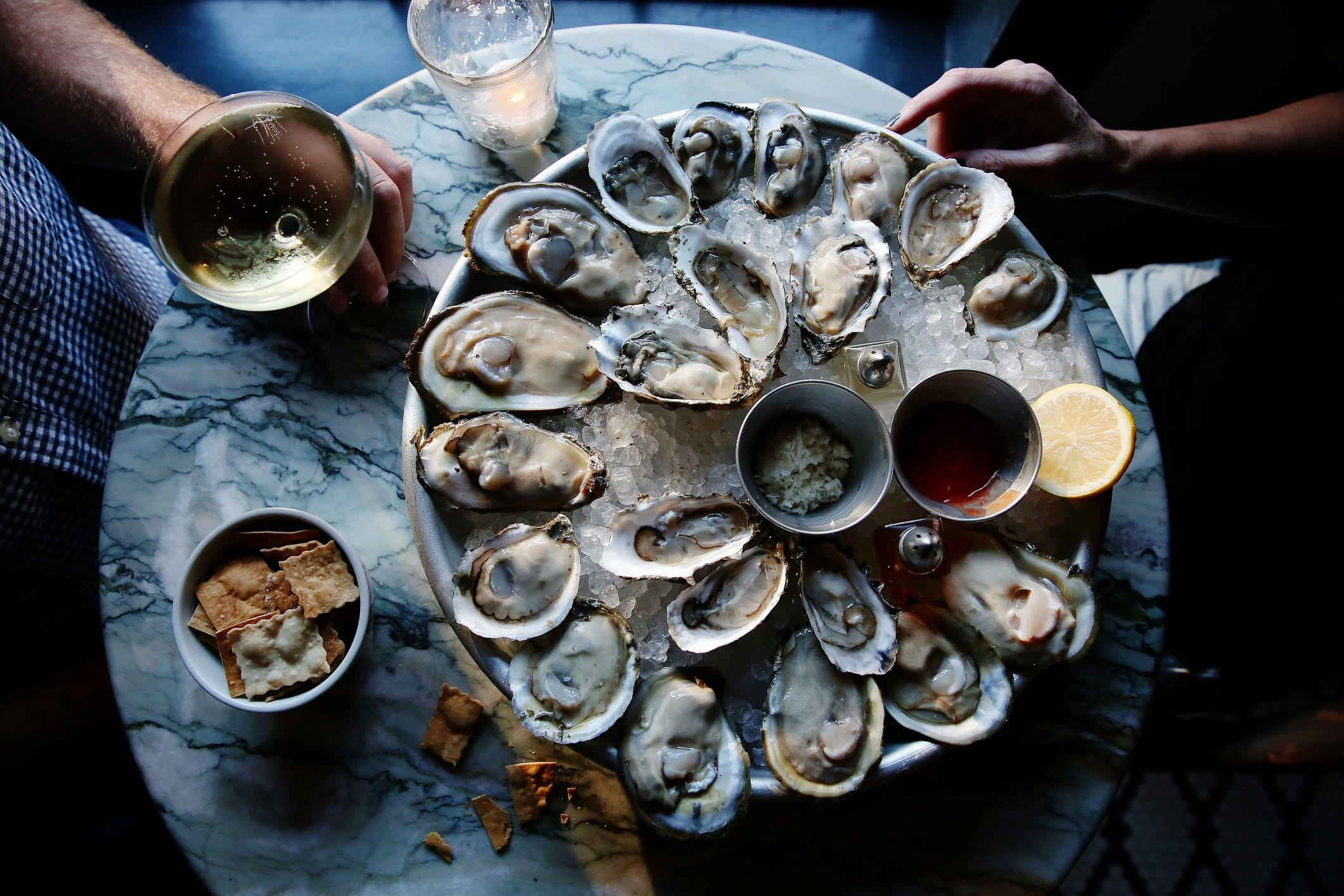 A platter of oysters on a table