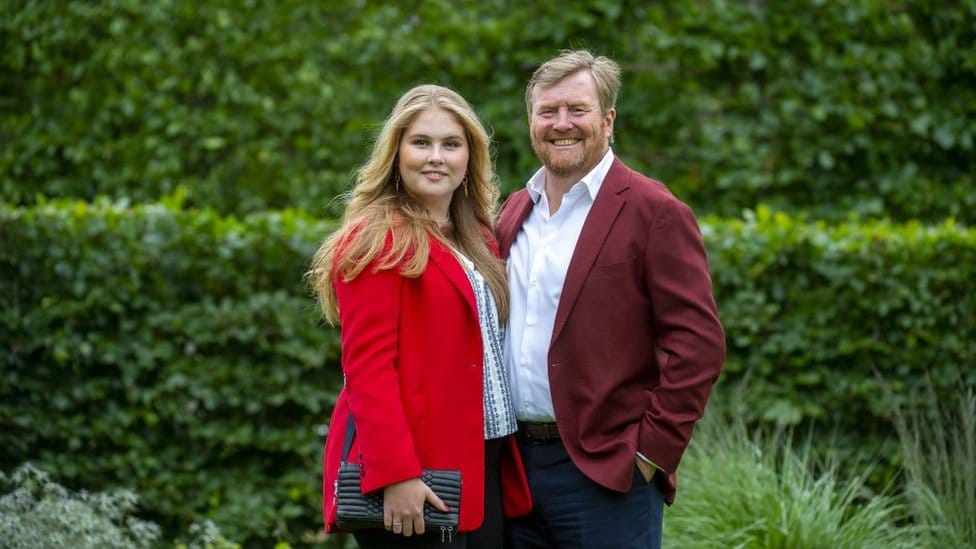 King Willem-Alexander of the Netherlands (R) and Princess Amalia pose during the summer photo session at Huis ten Bosch Palace in The Hague, on July 16, 2021