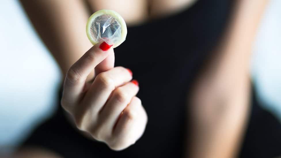 condom being held up